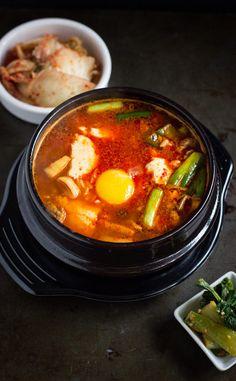 How to Make Soondubu Jjigae - Spicy Korean Soft Tofu Stew with Seafood. This dish is traditional Korean comfort food! Read Recipe by the_fifthhouse Seafood Soup, Seafood Recipes, Soup Recipes, Cooking Recipes, Family Recipes, Korean Dishes, Korean Food, Top 14, Soondubu Jjigae