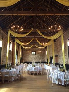 Yellow draping in The Granary Barn #granarybarns #granaryestates #elizabethhalleventstylist #yellowdrapes #barnwedding #countywedding