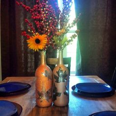 Any extra wine bottles laying around, very easy fall decor. Just hot glue some leaves on the bottle and spray paint with any color you'd like. Once dried take the leaves off and clean the excess glue off. Tada! You got a cute fall vase!