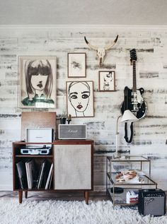 Love this funky industrial style wall collage, complete with guitar and skull!