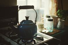Our kitchen, our tea pot, our sunlight coming in through the window above the sink. We should have a brightly colored tea pot. How about green, or Polaroid yellow?