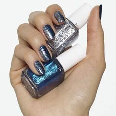 festive fringe by essie - give your dark, shimmery blue polish a side of glam with a sparkly fringe top coat — a nail design that's definitely cause for celebration.