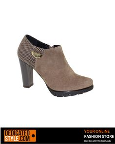 A heeled boot adorned with suede for a woman enjoys a classy look. Available in Black, Taupe or Blue. High quality Portuguese footwear.