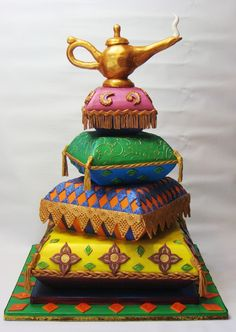 """Arabian Pillow Cake Pillow cakes """"bedazzled"""" with genie lamp topper Pretty Cakes, Cute Cakes, Beautiful Cakes, Amazing Cakes, Yummy Cakes, Beautiful Things, Pillow Cakes, Pillows, Arabian Nights Theme"""