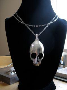 silver skull spoon necklace.