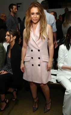 Alyssa Milano from Stars at New York Fashion Week Spring 2016  She works a blush tuxedo vest-turned-dress front row at Marissa Webb.