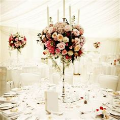 with lots of vintage roses and David Austin roses, hydrangeas, scented stocks and Oriental lilies