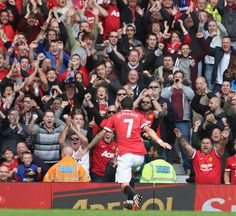 Angel Di Maria embarks on a passionate celebration with the @manutd fans after his goal in the win over Everton on 5 October 2014.