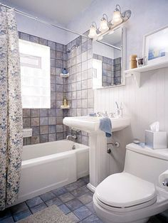 Tough, Terrific-Looking Tile - kind of like a updated retro bathroom ideal - tile everywhere. The wood-paneled wall softens the smaller bathroom. And I like it.