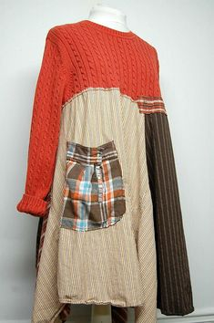 This unique long boho tunic is constructed of an array of cotton fabrics creatively stitched to a rust cable knit sweater. It is adorned with an oversized flannel pocket on the front and shabby patches on the back. So cute worn over tattered jeans or leggings for a lagenlook style.