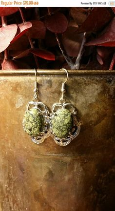 Check out this item in my Etsy shop https://www.etsy.com/listing/269409979/summer-clearance-sale-zoisite-earrings
