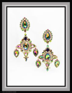 Very elaborate and elegant chandelier earrings feature vintage Vitrail stones that show colours of green, gold, purple, mauve, blue as they dance about - surrounded by accent stones in Chrysolite, Gold, Rose, Light Rose and Amethyst - gold plated  - Made by Bryan Greenwood of Crystal Countess / Jewellery by Greenwood Design
