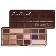 """TOO FACED Палетка Теней The Chocolate Bar Eye Palette Отлично подобранная комбинация матовых и мерцающих оттенков поможет создать безупречный макияж, от легкого дневного до насыщенного """"смоки айс"""". Благодаря содержанию в составе теней антиоксиданта в виде экстракта какао, эта палетка благоухает удивительным ароматом шоколада. Тени обладают насыщенной пигментированностью и очень легки в растушевке, что позволяет добиться профессионального результата."""