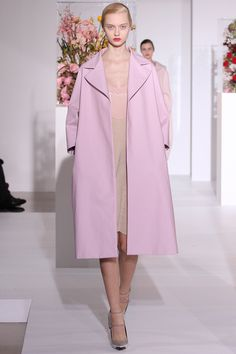 jil sander --> LOVE the retro coat style and color; model needs a big bowl of mashed potatoes.