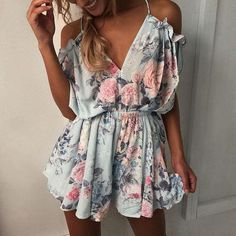 The Light Blue Floral Romper. This sweet flowy romper is the perfect go-to for the hot days. Featuring off the shoulder sleeves with a tie open back and ruffle shorts. Pair it with sandals and a choker necklace. Check it out at www.everythingrompers.com