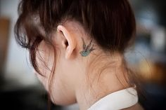 behind ear tattoo- American traditional swallow.