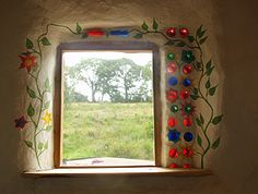 Love these bottles and vines built into the walls.so pretty! For my cob house. Cob Building, Green Building, Building A House, Bottle House, Bottle Wall, Glass House Design, Wall Design, Earth Bag Homes, Earthship Home