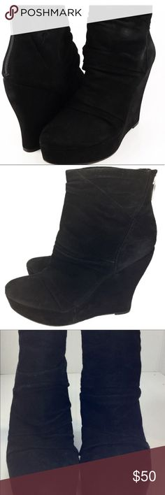"""DESIGNER Black Suede Wedge Heel Booties Beautiful, designer Boutique 9 Wafer Platform Booties in Size 7.  The soft black suede covers the wedge heel and drapes the upper boot to create a ruched detailing that look stunning when worn with black tights.  The rounded toe looks worn in the photos, but have a rubbed toe style with only minor evidence of all the nights out on the town.  Love these booties, but they need more adventures!      SIZE: Women's Size 7 • Wedge Heel:  4 3/4"""" • Platform…"""