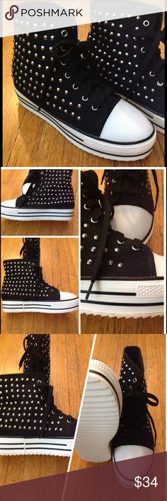 """BLACK PLATFORM STUDDED HIGHTOPS These great high tops have a 1.5"""" platform with a 5"""" back ankle rise. They are a size 8 but keep in mind that it is common to go to a slightly smaller size with sneakers as the insoles are flat and wider. These shoes have an instep similar to a pair of converse however; they are slightly wider. The measurements of the insole flatbed are 9.5"""" long & 3"""" wide at the ball of the foot. They are new however; there are a couple faint pinkish spots on the white rubber…"""