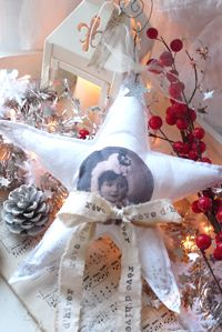 Star ornament...Would love to make these with old black & white photos of my Granny & Granpa & hang from a  special lil sparkly rememberance tree...