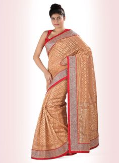 Evolve into a jewel of inestimable value as as you wear this shade uppada silk designer saree. Embroidered contrast yoke part and diamond work, silk border patch work and stone work gives it an authen...