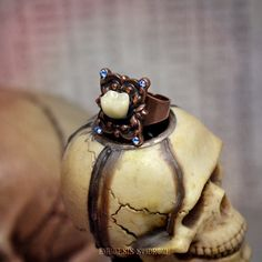 Creepy Molar Ring : antique copper adjustable ring, greyish blue Swarovski chatons, and creepy acrylic human tooth, by Anamnesis Syndrome