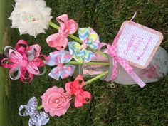 A hair bow bouquet for baby showers or birthdays, something totally unique that is sure to impress! Custom orders only right now -- pick your color theme and types of bows. Contact Jess at mommyandmeboutique8@gmail.com or visit Etsy at www.etsy.com/shop/mommyandmeboutique8
