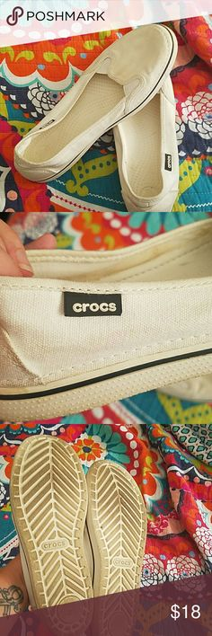 Comfy Crocs Off white with a navy blue stripe slip on ladies Crocs. crocs Shoes Flats & Loafers