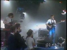 New Order, consisting of former Joy Division members and nervous vocalist Bernard Sumner, performing  Ceremony, live at Celebration 1981, a year after Ian Curtis's death