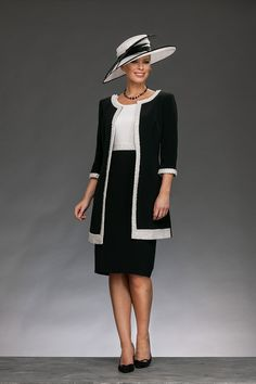 Knee length elegant shift dress with high round neck and capped sleeves. The top of the dress is contrasting to the skirt and has a beaded pearl belt to separate. The matching coat is collarless and has a beaded edge round the coat and cuffs. Product Code: 008889 Colour: Navy/Ivory