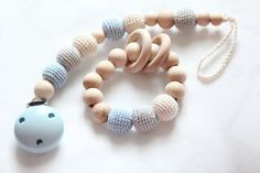 Hey, I found this really awesome Etsy listing at https://www.etsy.com/listing/293767687/set-pacifier-clip-with-teething-bracelet