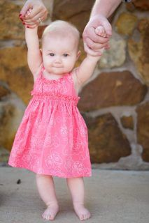 6 month photo idea - can we get the twins to hold hands and then we hold on the outside?