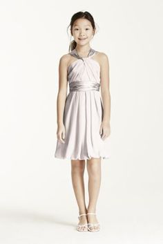 Youthful and fun, thiscrinkle chiffon and charmeuse short dress is perfect for the Junior Bridesmaid.   Y-neckline gives this dress a modern twist and adds interest.  Soft chiffon drapes beautifully into a bubble hem, while the charmeuse adds a touch of shine to the look.  Coordinates beautifully with any of our chiffon or charmeuse bridesmaid dresses.  This style features an adjustable fit foradded flexibility and comfort with fewer alterations.  Fully lined. Back zip. Imported polyester…