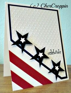 handmade Fourth of July card ... graphic red and white stripes on the diagonal ... three punched blue stars follow the diagonal .. strong clean lines ... great card!!