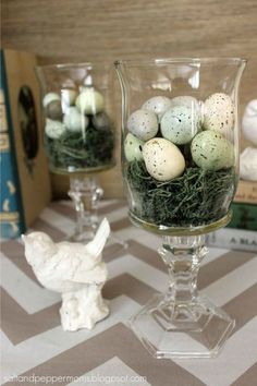 Easter Nest Hurricane Glasses: Spotting a pretty bird's nest outdoors is always a special sight. Thanks to the dollar store, there's an easy and inexpensive way to bring that natural beauty home for less than $12. Click through to find more easy and cute DIY dollar-store Easter crafts. #easter_crafts_dollar_store