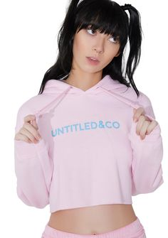 """Untitled & Co Southbeach Crop Hoodie will take ya on a vacay. This lil pink hoodie has a cropped length and blue """"UNTITLED&CO"""" text on the front."""