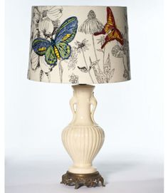 "A monochromatic flower print recedes to let bold embroidered butterflies take flight. ($88; 12""W x 81⁄2""H; anthropologie.com)"
