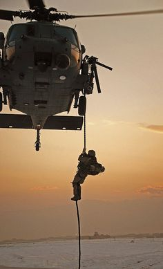 A para-rescueman from the Alaska Air National Guard's 212th Rescue Squadron conducts fast rope insertion training while deployed to Bagram Air Base, Afghanistan.