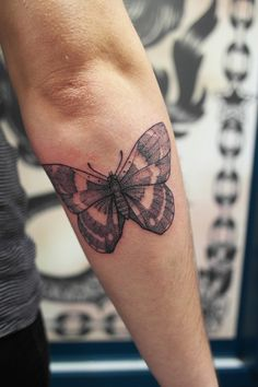 Soft and elegant looking butterfly! There're many symetrical ornaments on the wings and hollow spaces in the gaps. Tattoo is made with beautiful dot work!