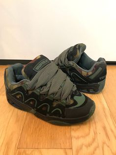 22e577bb9b0 -black nubuck upper with camo canvas and green rubber details.