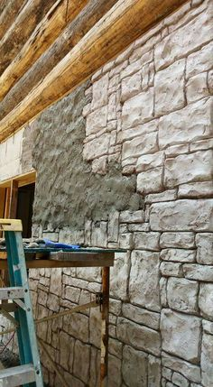A carved vertical concrete wall in progress.