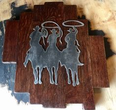 Beautiful wine barrel lid cut up with roping cowboys steel cutout wall hanging plaque. Made by Country Cowgirl's Creations. Check us out on Facebook!