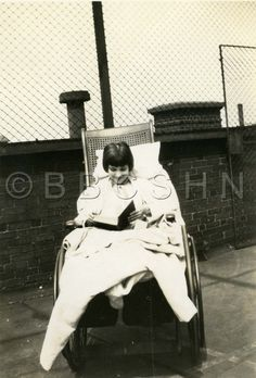 Young child in wheelchair reading, Woman's Hospital of Philadelphia School of Nursing, c. 1930. Image courtesy of the Barbara Bates Center for the Study of the History of Nursing.