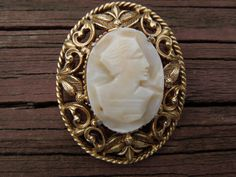 Vintage Florenza Brooch. Cameo. Hand Carved. Gold Tone. 1950's or 1960's. Signed.  Ask a Question $25.00 USD Only 1 available