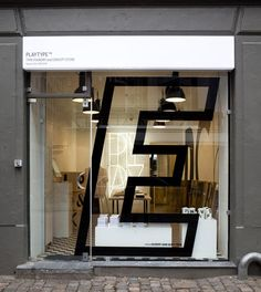 Glass facade sign at Playtype foundry and concept store by e-Types Brick And Mortar, Wayfinding Signage, Signage Design, Store Signage, Directional Signage, Café Bistro, Shop Facade, Window Graphics, Retail Windows