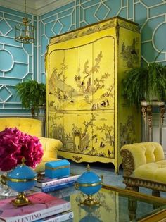 Yellow chinoiserie cabinet and faux bamboo walls