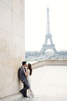 A destination engagement shoot in Paris with the iconic Eiffel Tower as a backdrop // Tres Chic: Agung and Vili's Parisian Engagement