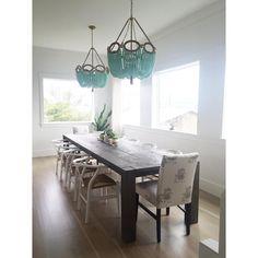 dark wood table + beaded chandelier
