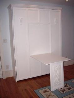 Murphy bed with drop down table.  I like the Arts & Crafts style and Nouveau feature on the table leg. For an office / bedroom, I'd also put a mirror in the table recess.