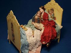 doll with her doll (plus Mom and a book!), by Gale Elena Bantock